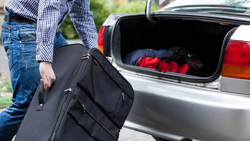 Desembarque de passageiros com suas bagagens é PARADA ou ESTACIONAMENTO?